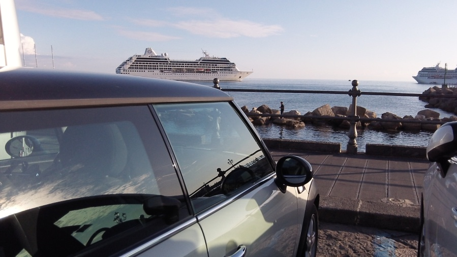 MINI in Amalfi, Italy with Oceania's Nautica in the background.